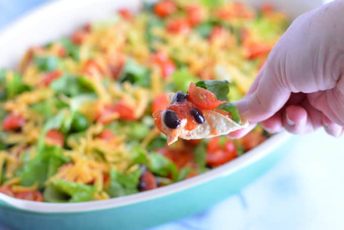 Taco Dip made with lower calorie ingredients adds a healthier choice to your next party menu.