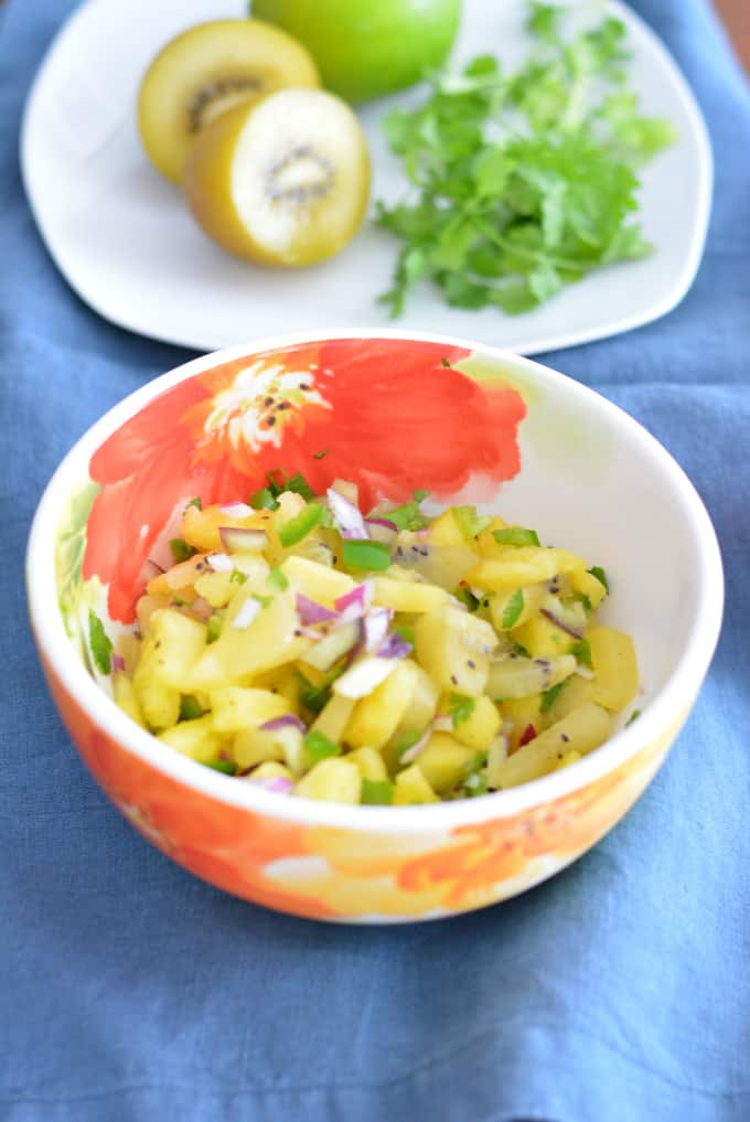 Kiwi Pineapple Fruit Salsa in a flowered bowl.