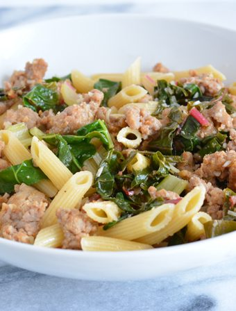 Quick dinners are a necessity. Sausage with garlic Swiss chard over penne is a quick and simple recipe that can be put together in under 30 minutes.