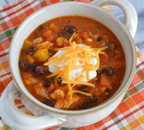Leftover Turkey chili made with pumpkin puree, black beans, and butternut squash. A perfect way to use up leftover turkey.