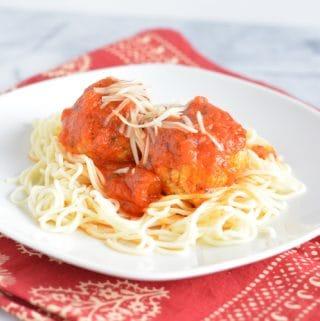 Turkey Meatballs with spaghetti on a plate.