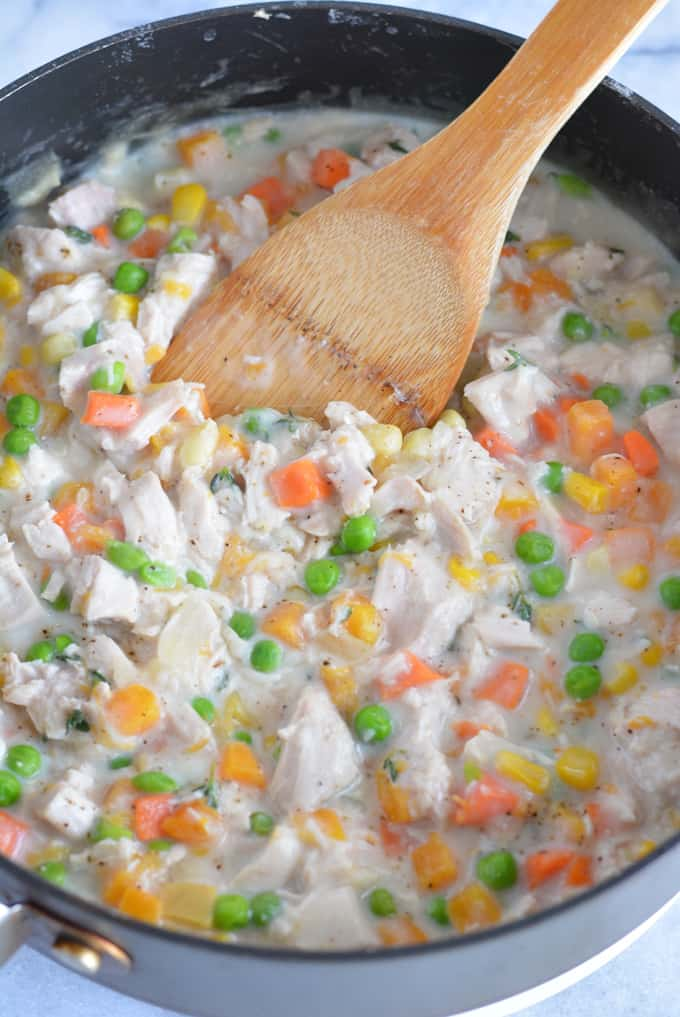 Leftover Turkey pot pie filled with lots of veggies perfect for using up leftover turkey from your Thanksgiving feast.