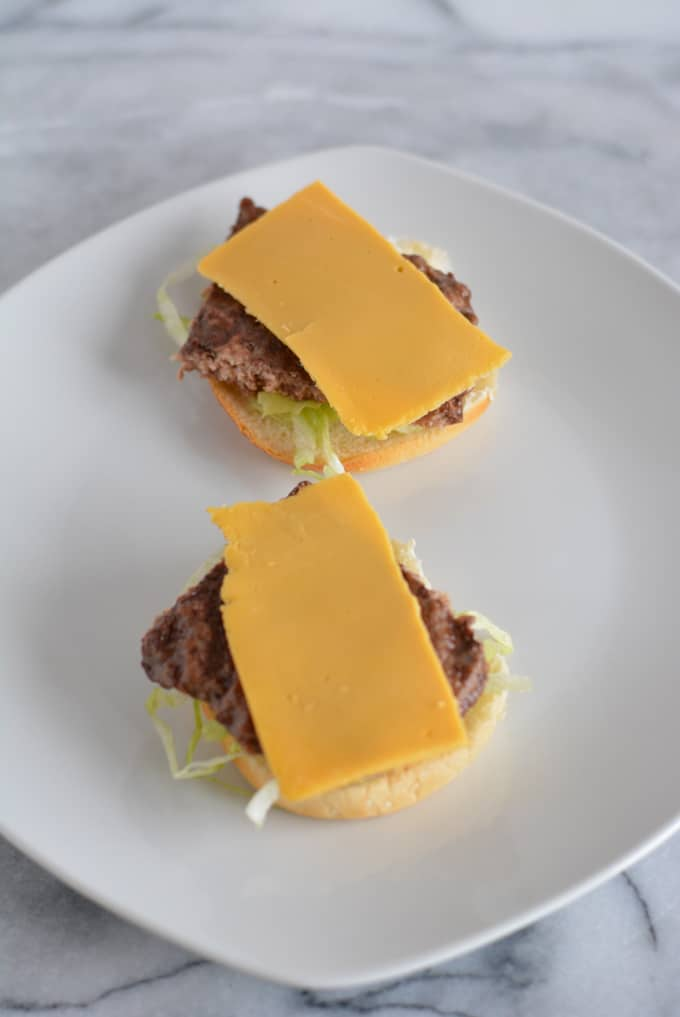 Open faced cheese burger.