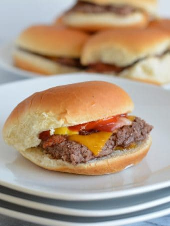 Bacon Cheddar Sliders are the perfect game day snack. Baked in the oven there is no need to turn on your grill. Pepperidge farm sliders make game day easy. #sponsored #easyrecipes #gamedayrecipes #respectthebun #snacks #sliders #burgers
