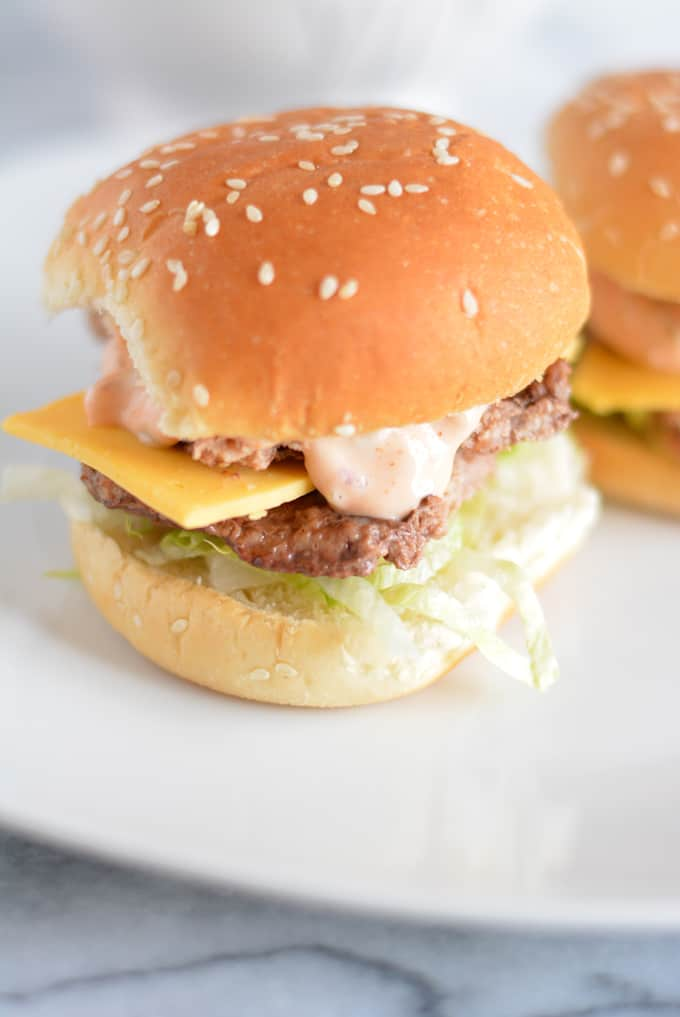 Mini big mac sliders on a plate.